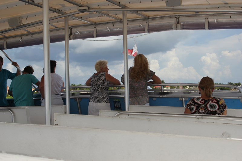 Passengers look out over the Gordon River aboard Pure Florida's M.V. Double Sunshine sightseeing cruise.