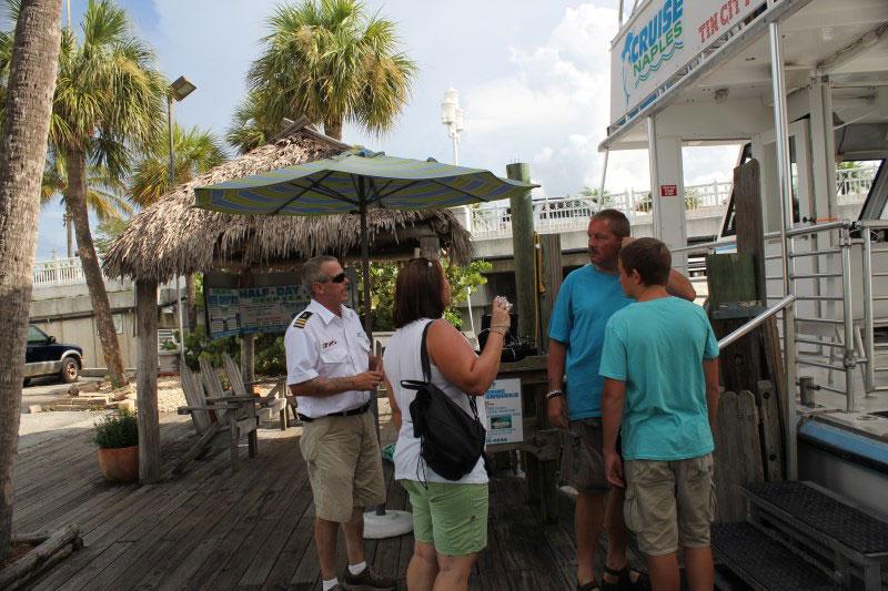Boarding Pure Naples M.V. Double Sunshine sightseeing cruise at Naples Tin City.
