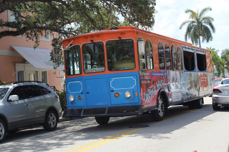 The Naples Trolley Tour on Third Street South, Naples, Florida.