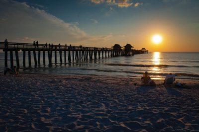 MustDo.com | Sunset at the Naples Pier Beach in Naples, Florida.