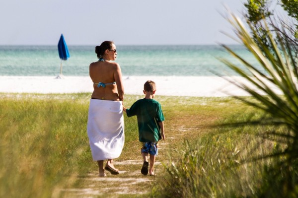 MustDo.com | Mother and son walk to white sand beach Siesta Beach Sarasota, Florida