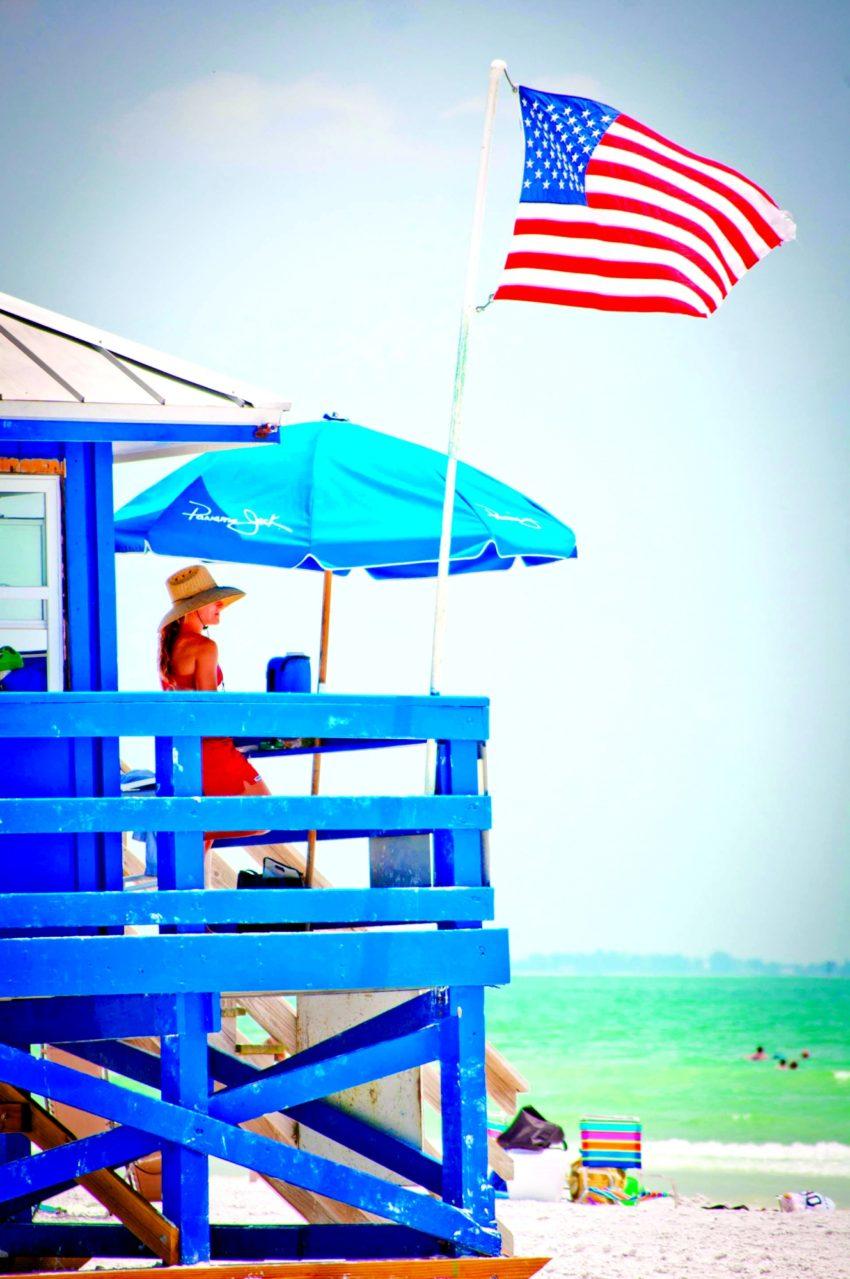 MustDo.com   USA flag, Gulf of Mexico, Siesta Key Beach Lifeguard stand Sarasota, Florida beaches
