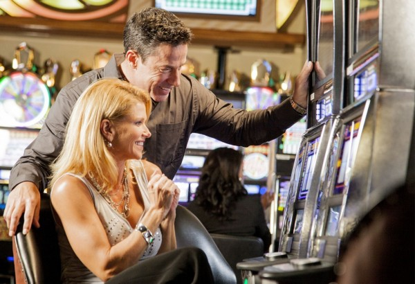 Couple playing slot machine at Seminole Casino Immakolee, Florida
