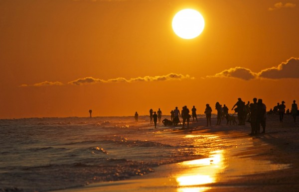 MustDo.com | Sunset on Siesta Beach on Siesta Key Sarasota, Florida. Photo by Marjie Goldberg Photography.