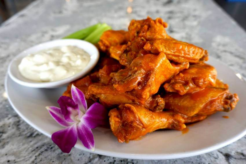Buffalo style chicken wings with dipping sauce at Daiquiri Deck Raw Bar restaurants in Siesta Key, St. Armands Circle, Sarasota, and Venice, Florida. Must Do Visitor Guides, MustDo.com.