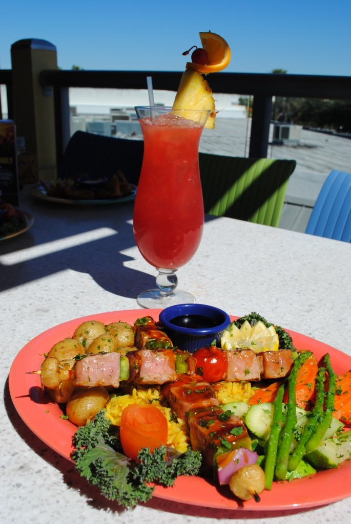 Daiquiri Deck Raw Bar shish-kabob with rice and grilled vegetables. Sarasota, Florida