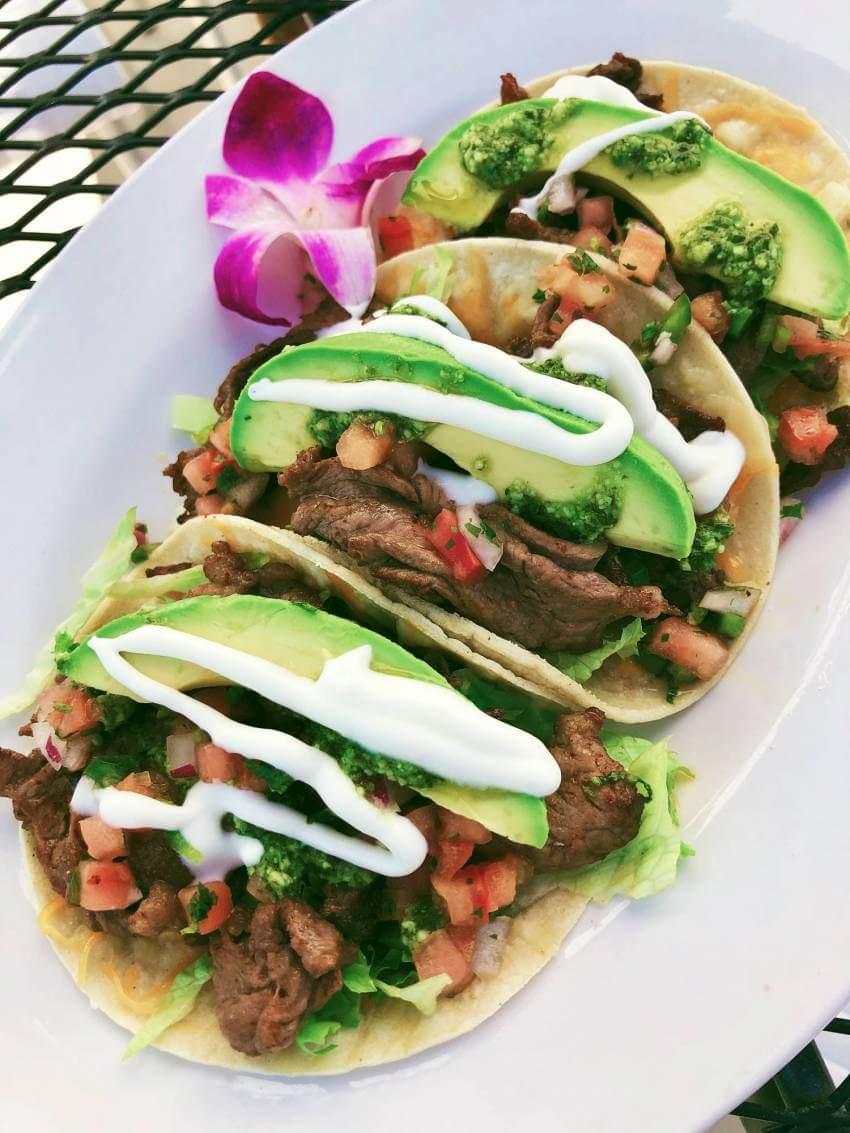 Shaved Ribeye tacos at Daiquiri Deck Raw Bar restaurants in Siesta Key, St. Armands Circle, Sarasota, and Venice, Florida. Must Do Visitor Guides, MustDo.com.