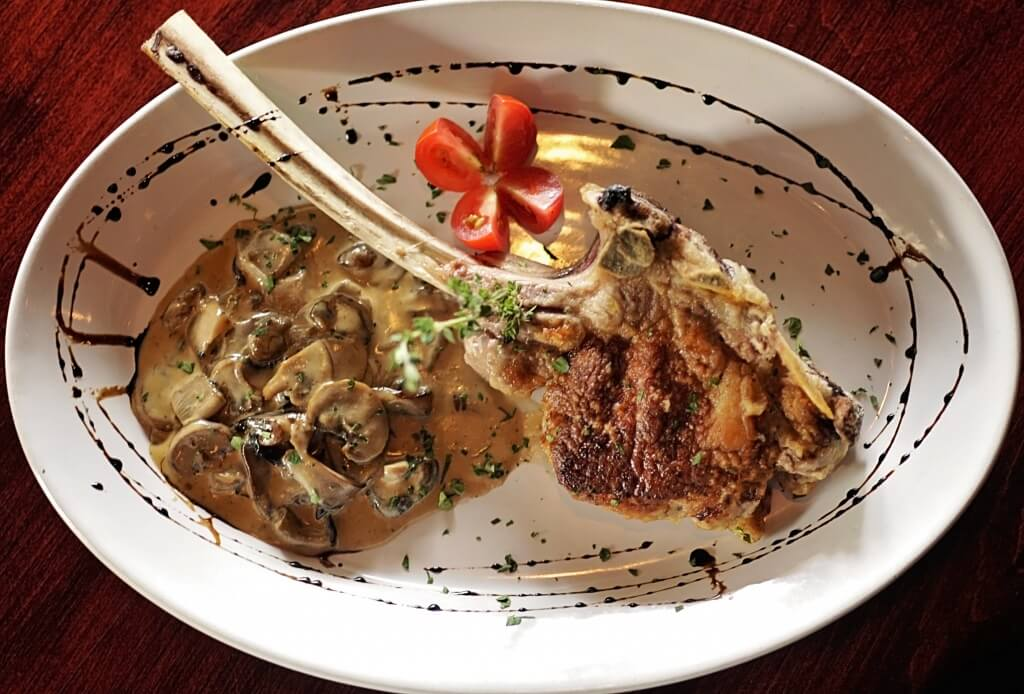 MustDo.com | Must Do Visitor Guides | Cafe Gabbiano Italian restaurant bone-in veal entree Siesta Key, FL