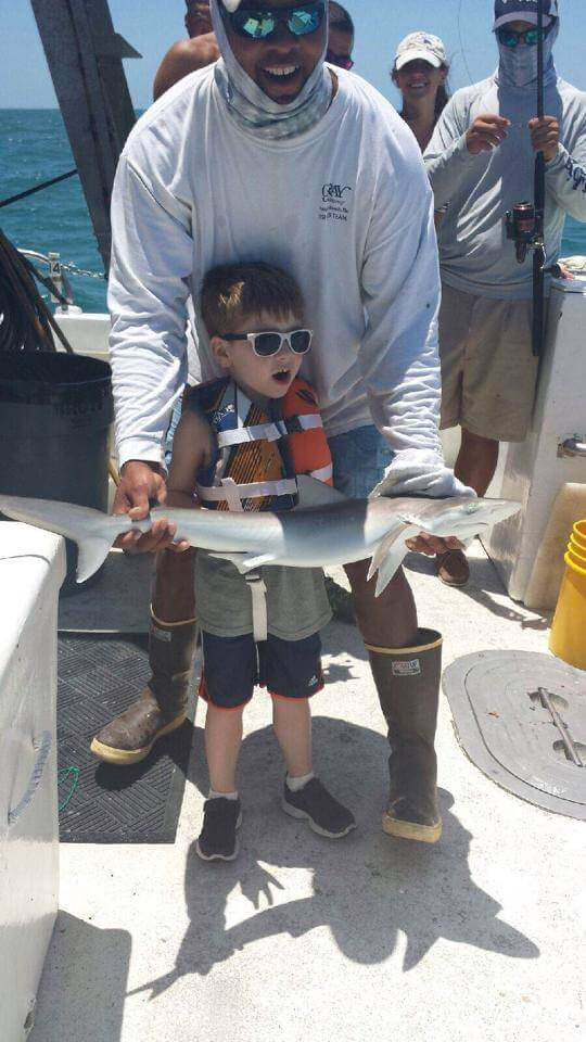 Exciting! Five year old's first shark catch aboard Sea Trek in Fort Myers Beach, Florida