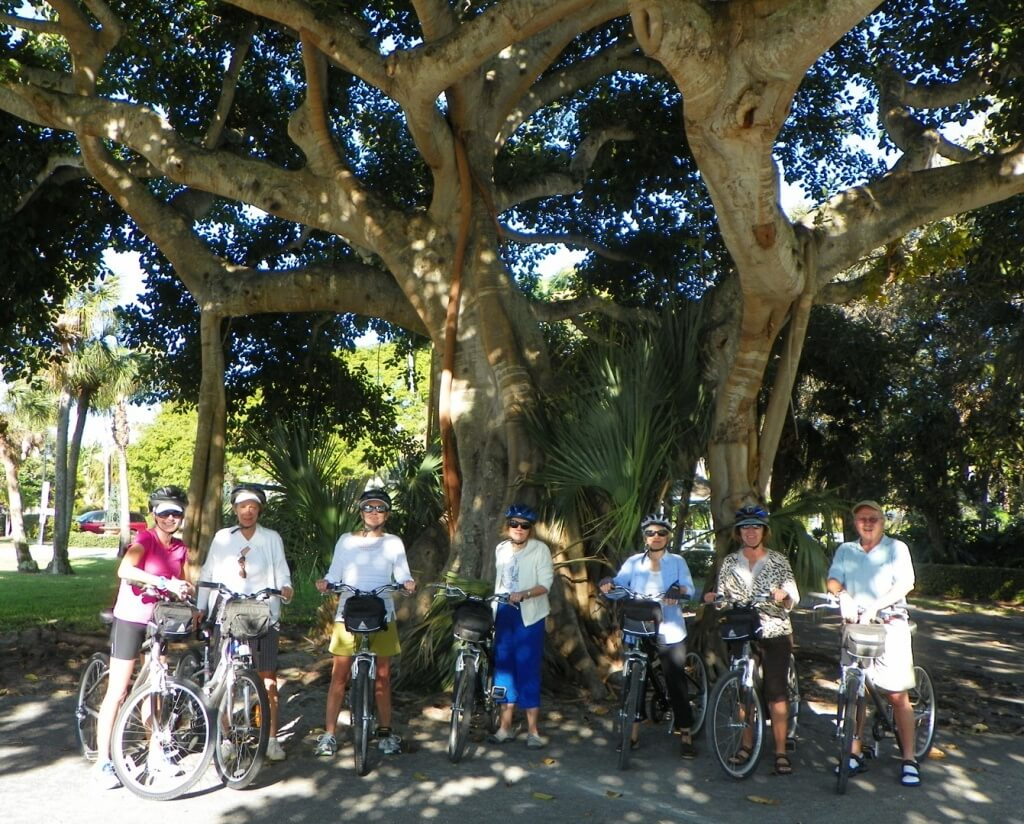 MustDo.com |Bike Tour posing under the Banyan Tree in Old Naples with Naples Bicycle Tours Naples, FL