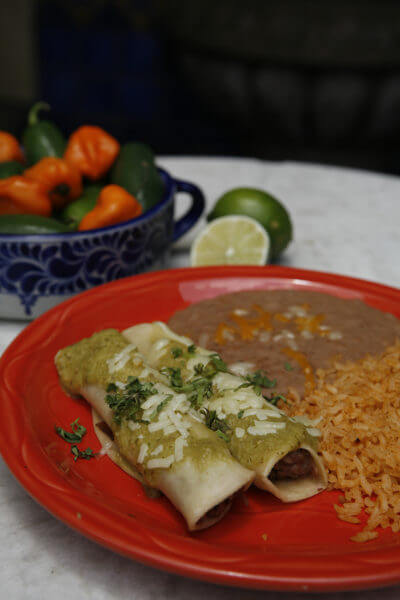 MustDo.com | Enchilada, beans and rice from Mi Pueblo Mexican restaurant Sarasota and Venice, Florida