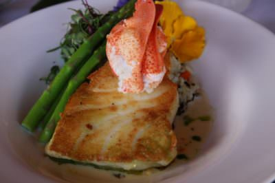 MustDo.com | Pan seared fish topped with lobster from South Beach Grille Ft. Myers Beach, Florida