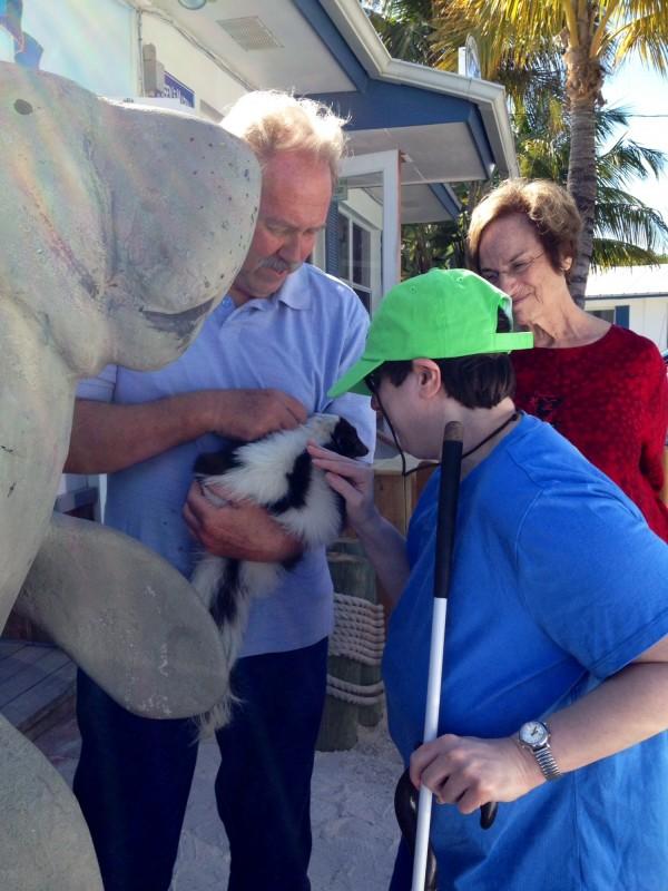 MustDo.com | Petting a skunk on Captain Bubby's IsLAND Tour Sanibel Island, FL