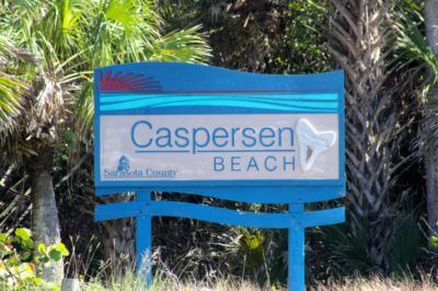 The sign welcoming visitors to the Sharks Tooth Capitval of the World - Caspersen Beach Venice, Florida. Must Do Visitor Guides, MustDo.com.