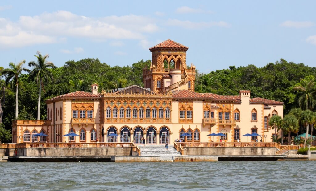 MustDo.com | The Ringling Ca d Zan Mansion from Sarasota Bay in Sarasota, Florida. Photo credit Nita Ettinger.