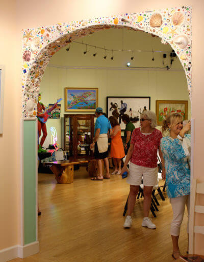 MustDo.com | The whimsical Lee Family Arch doorway at Marietta Museum of Art & Whimsy Sarasota, Florida. Museum founder and curator Marietta (Mary) Lee.