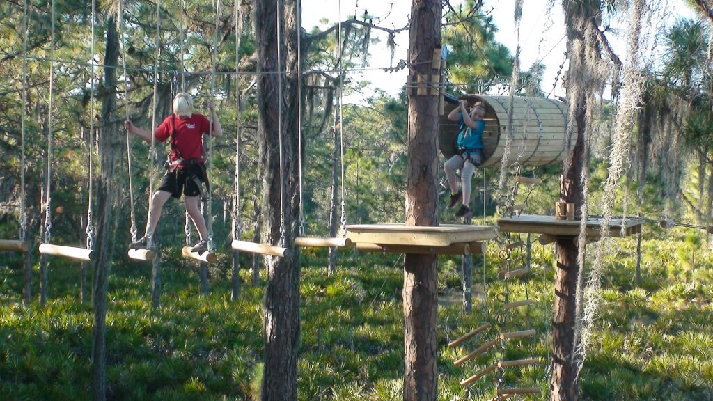 MustDo.com | Climb, swing, jump and zip line TreeUmph! Bradenton, Florida