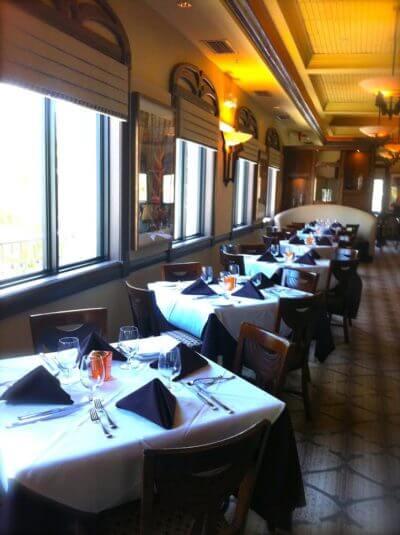 MustDo.com   Casually elegant dining room at Il Cielo Italian restaurant on Sanibel Island, Florida
