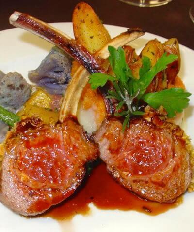 MustDo.com | Roasted potatoes, califlower and lamb chops in a demi-glaze sauce Il Cielo Italian restaurant Sanibel Island, Florida