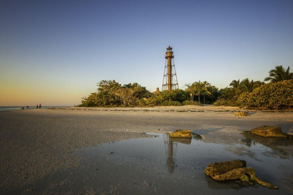 MustDo.com | Sanibel Island Lighthouse and beach at low tide Sanibel Island, Florida USA. Photo by Jennifer Brinkman.