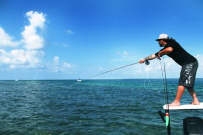 Fisherman casting his line in the Gulf of Mexico in Southwest Florida. Photo by Elizabeth Lempriere.