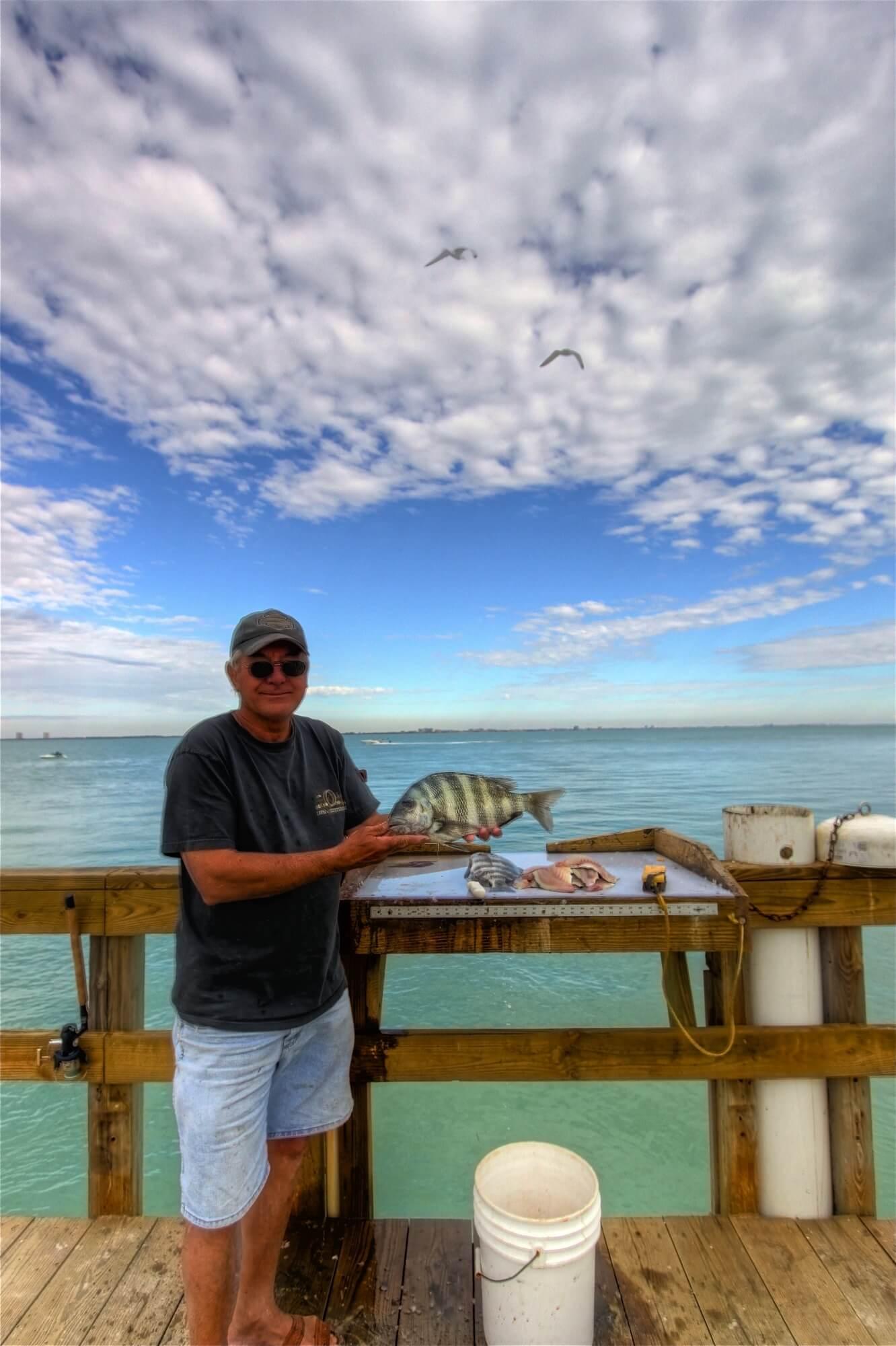 MustDo.com | Fisherman shows off his catch Sanibel Fishing Pier Sanibel Island, Florida