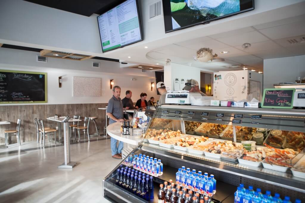 Captain & Krewe seafood beautifully presented in refrigerated displays, you'll find a tempting array of fresh fish, stone crabs and shellfish to take home and cook. Naples, Florida restaurant and seafood market.