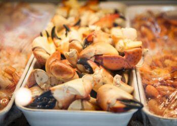 MustDo.com | Fresh Stone crab claws Captain & Krewe Seafood Market & Restaurant downtown Naples, Florida.