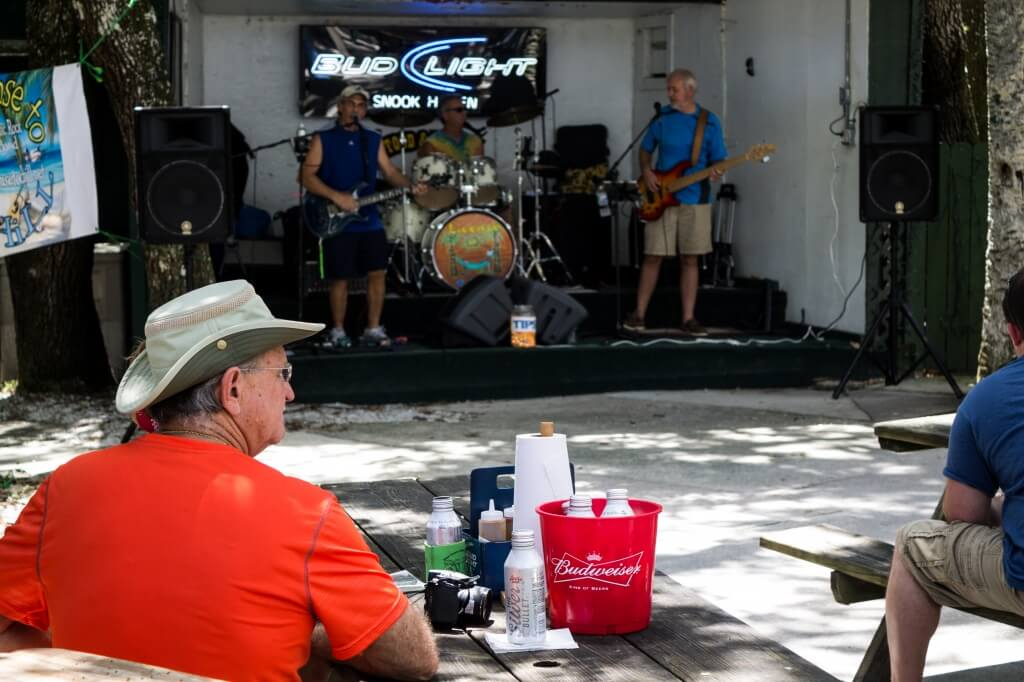 MustDo.com | Snook Haven Old Florida-style restaurant is in a prime location for enjoying a relaxing meal or drink, especially when live bands play bluegrass and other music at the entertainment stage area.