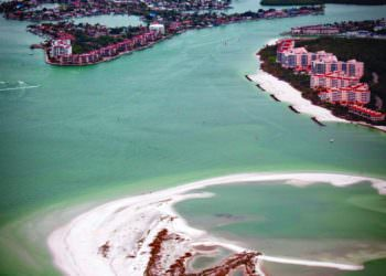 MustDo.com | Aerial view of Gulf of Mexico, white sand beaches of Marco Island, Florida