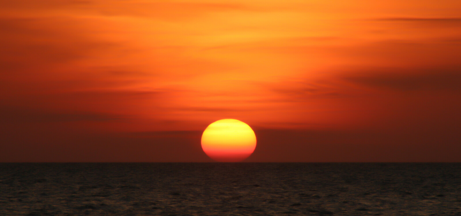 MustDo.com | Sunset into the Gulf of Mexico Florida, USA. Photo by Mary Carol Fitzgerald.