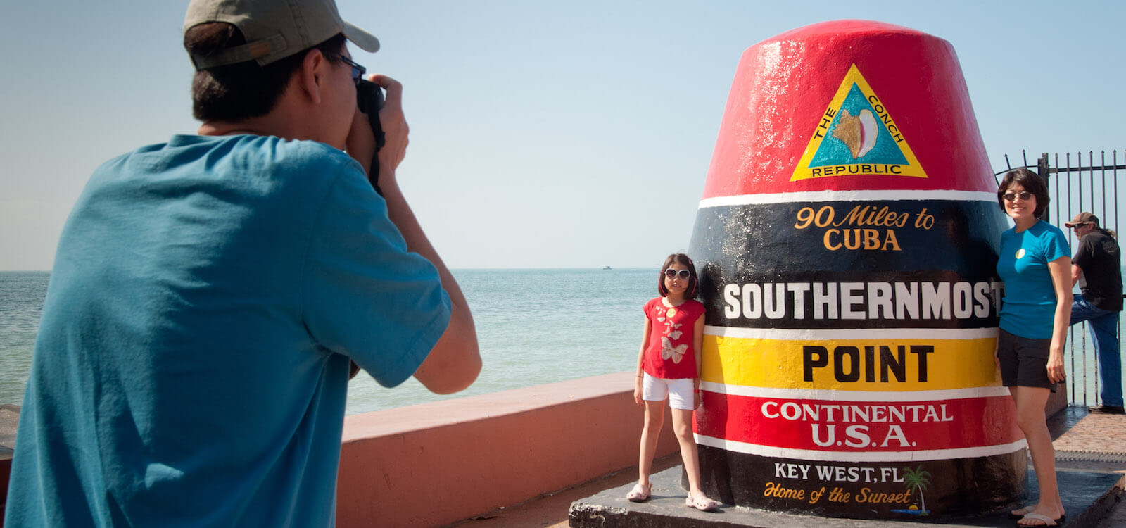 Snapping photos at Southernmost Point, 90 miles to Cuba, Key West, Florida, USA, Feb. 22, 2011. Photo by Debi Pittman Wilkey