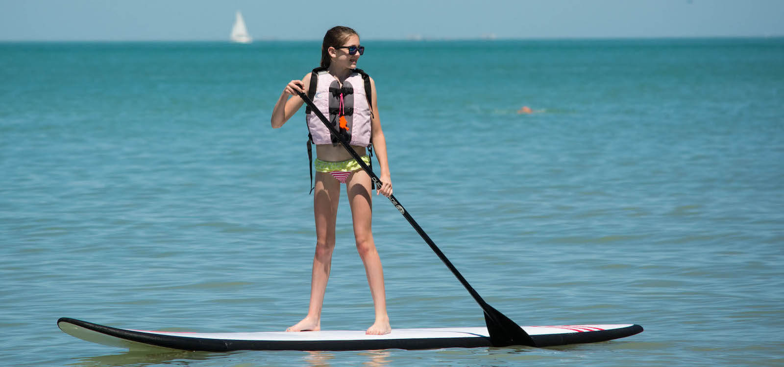 MustDo.com | Stand Up Paddleboard on Gulf of Mexico at Vanderbilt Beach, Naples, Florida, USA. Photo/Debi Pittman Wilkey