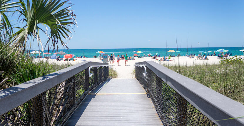 Beach pathway to Nokomis Beach. Nokomis Beach is Sarasota Counties oldest public beach and is well-liked by families and fishing enthusiasts. Though not as prevalent as on Caspersen Beach, there are shark's teeth that can be found washed up on this Casey Key, Florida beach. Photo by Jennifer Brinkman. Must Do Visitor Guides, MustDo.com.