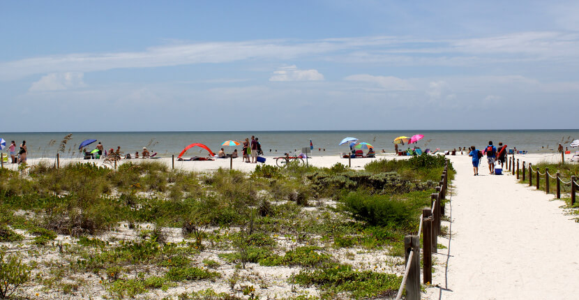 MustDo.com | Must Do Visitor Guides, beach path to Bowman's Beach on Sanibel Island, Florida USA.
