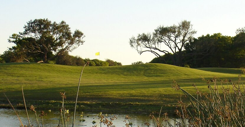 MustDo.com | Hole number 14 at public golf course Coral Oaks Golf Course, Cape Coral, Florida. Must Do Visitor Guides Florida vacation information.