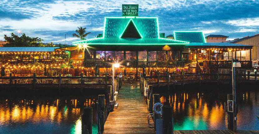 MustDo.com | Doc Ford's Rum Bar & Grille waterfront bar and restaurant on Fort Myers, Beach, Florida. A great spot for dinner, to watch the game, and enjoy a cold beer or cocktail.