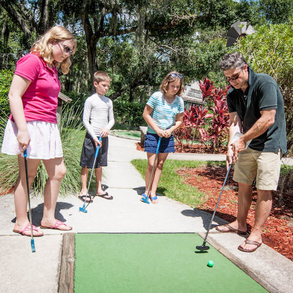 Evie's Family Golf Center features an 18-hole waterfall adventure mini-golf course, pizzeria and ice cream parlor, arcade, driving range, chipping and putting greens. Must Do Visitor Guides, MustDo.com