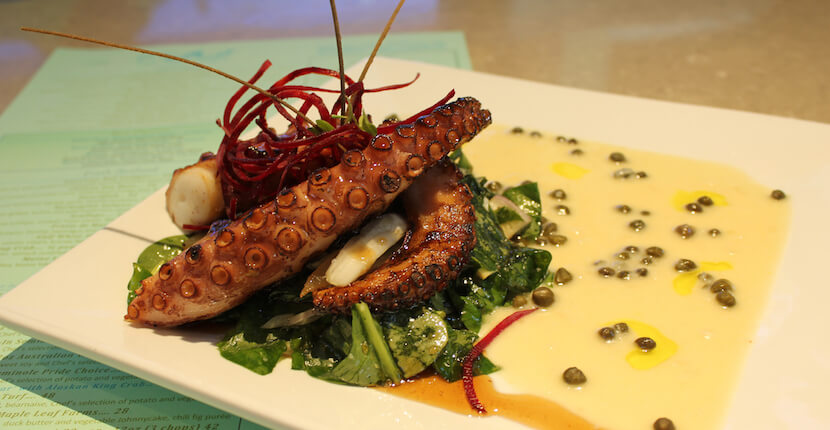 Grilled octopus, Fins at Sharky's waterfront restaurant Venice, Florida USA. Must Do Visitor Guides | MustDo.com