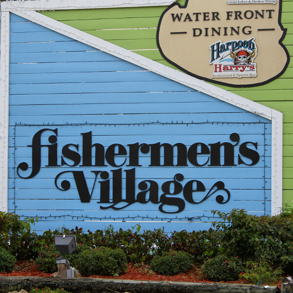 Located on pristine Charlotte Harbor in Punta Gorda, Florida, Fishermen's Village is just a short drive from Sarasota and Venice making it an easy day trip. Fishermen's Village shopping, dining, marina in Punta Gorda, Florida. USA. Must Do Visitor Guides, MustDo.com.