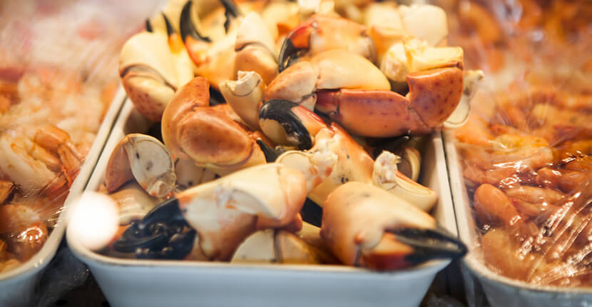 MustDo.com | Stone crab at Captain & Krewe Seafood Market and Raw Bar downtown Naples, Florida offer lunch, dinner, and Happy Hour served in a friendly atmosphere. Photo by Mary Carol Fitzgerald.