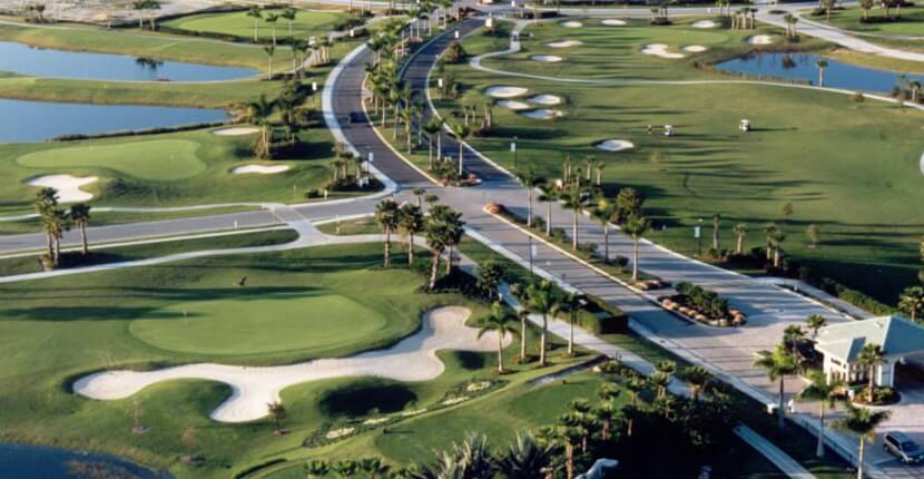 MustDo.com | Aerial view of Heritage Palms semi-private golf club featuring two challenging 18-hole Jed Azinger and Gordon G. Lewis designed championship golf courses, the Sabal and the Royal. Fort Myers, Florida.