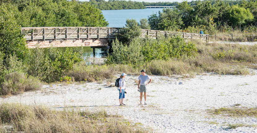 MustDo.com | Hikers at Lovers Key State Park in Fort Myers Beach, Florida. Must Do Visitor Guides.