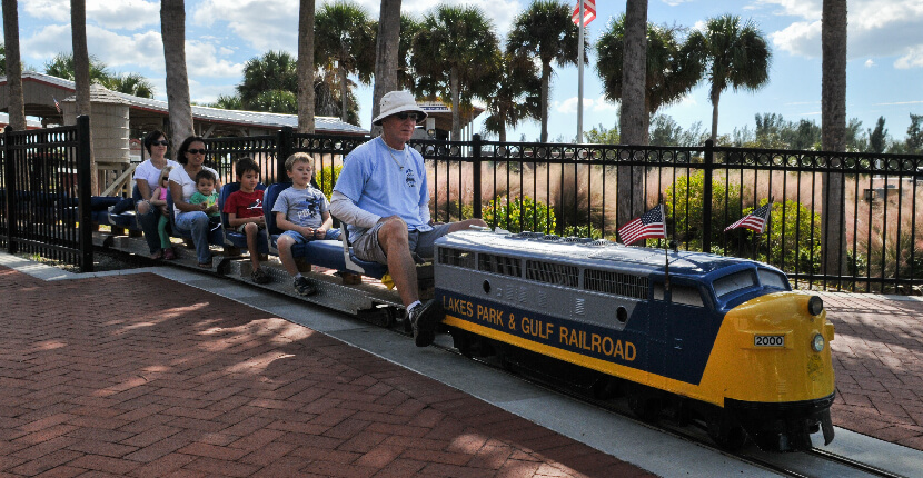 MustDo.com | Kids love the miniature train ride at Lakes Regional Park in Fort Myers, Florida.
