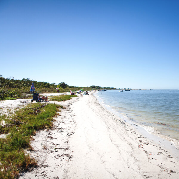 Lovers Key near Naples and Fort Myers has a stunning two–mile long sandy beach which was listed by the Travel Channel in the Top 10 Florida beaches. Photo by Mary Carol Fitzgerald. Must Do Visitor Guides.