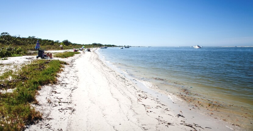 MustDo.com |The two-mile long beach at Lovers Key State Park in Fort Myers Beach, Florida, USA. Must Do Visitor Guides. Photo by Mary Carol Fitzgerald.