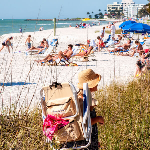 Lowdermilk Park on Naples Beach is a popular beachfront park with a duck pond, two children's playgrounds, sand volleyball courts, picnic tables, concession, restrooms, and outdoor showers. Photo by Jennifer Brinkman. Must Do Visitor Guides.