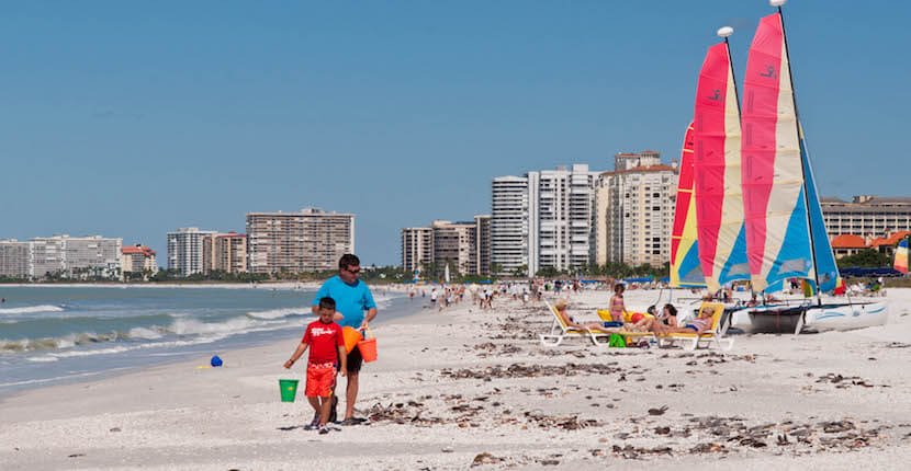 MustDo.com | South Marco Island Beach Access is one of two public beach access points on Marco Island – and the less busy of the two. This is a terrific beach for families to go shelling, beach fishing, or to watch dolphins playing in the surf. Photo by Debi Pittman Wilkey.