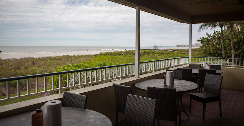 "MustDo.com | The Sunset Grille is a fantastic spot to watch the sunset and was voted ""Best Beach Bar"" and ""Best Sports Bar"" on Marco Island! Photo by Mary Carol Fitzgerald."
