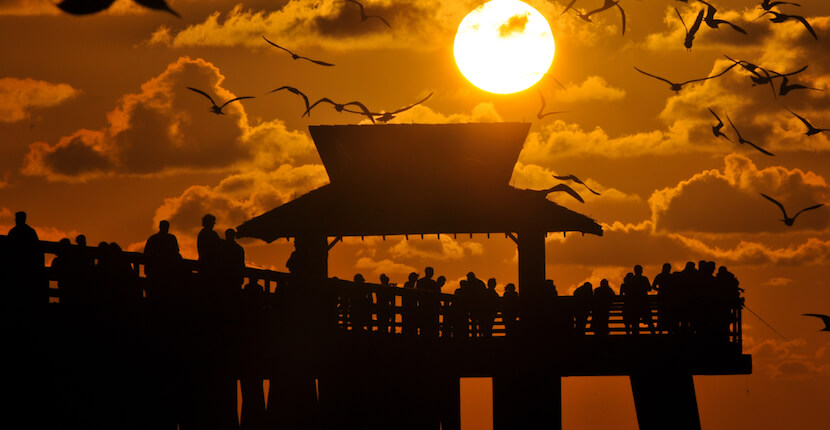 MustDo.com | Sunset at the Naples Pier in Naples, Florida. Photo by Gary Jung. Must Do Visitor Guides Florida vacation information.